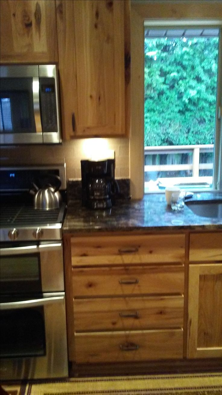 My kitchen with rustic hickory cabinets oak floors Rio Carmelo granite counters and tile accents