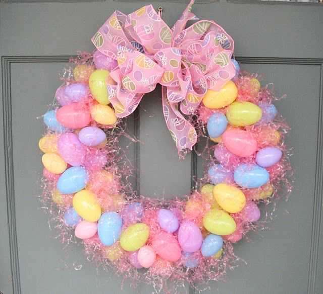 Super Simple Easter Wreath.  Use a plain wreath from the craft store, can be foam or whatever you want.  Hot glue some easter grass all over it, spreading it around.  Then hot glue your plastic eggs of various colors and sizes, stacking as you go.  Finish it off with a big bow.  Happy Easter!