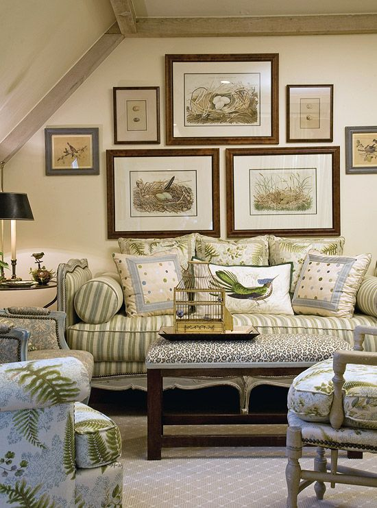 A symmetrical wallscape gives flight to the theme of this room, with antique prints of birds' nests framed in natural woods. An empty birdcage exudes optimism, while the subtle earth tones of the daybed make you feel like you are in your own little nest. A subdued cheetah pattern helps maintain a wild side: Every room, Faudree says, needs a little animal print.