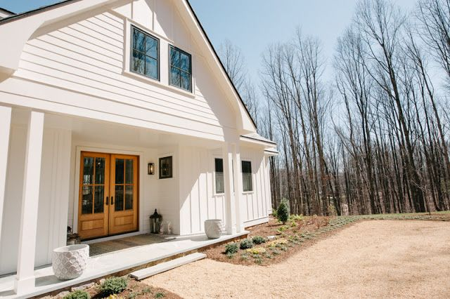 Modern Farmhouse Exterior In Rustic Lot With Now Porch