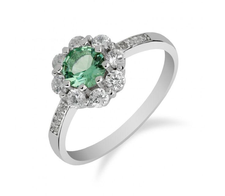 Výrazný stříbrný prsten s chrysolitem a zirkony okolo