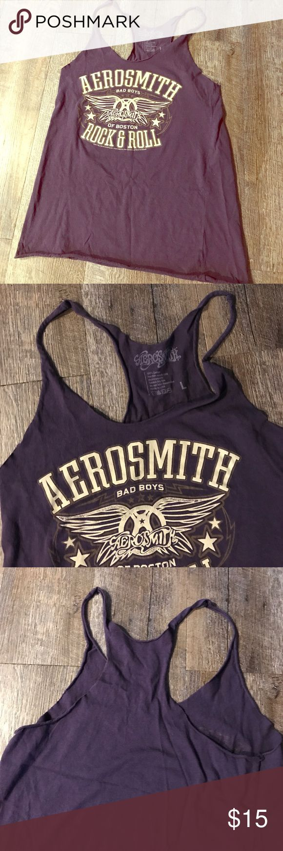 Aerosmith purple tank top shirt 70s classic rock Rarely worn! In great condition! Size fits small. Size is large but fits like a small/ medium. Bust is 34. Has the vintage look, faded coloring, and cut of sleeves. Great for everyday fashion or working out. aerosmith Tops Tank Tops