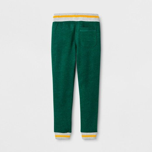 Keep your little dude stylishly comfortable in the Jogger Pants from Cat & Jack™. This solid green pant with pops of primary colors makes for a youthful look he can sport to school or when he's laying low at home. Pair these jogger sweatpants with cool kicks and a graphic tee for a stylish loungewear ensemble. $15
