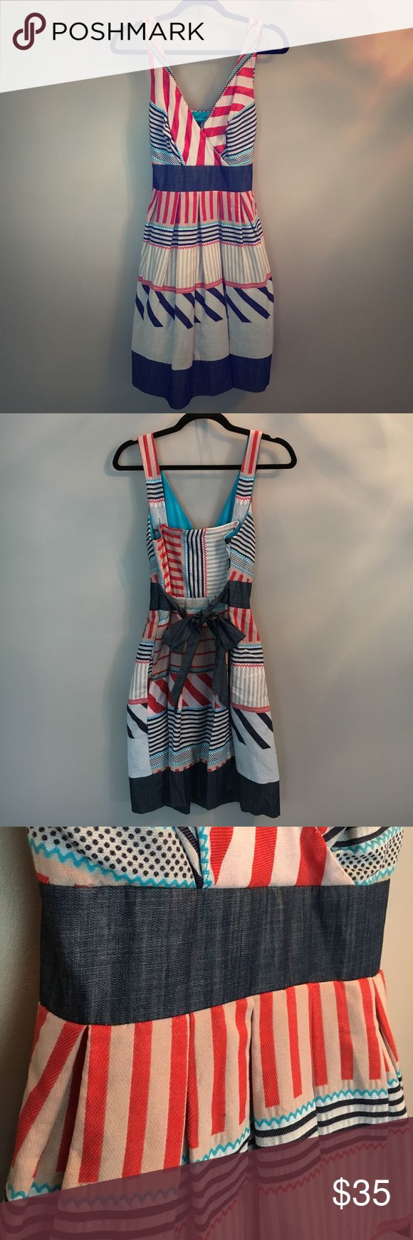 Patterned Bow Back Dress Red, white and blue patterned dress. Bow detail in back. Adjustable straps. Great condition. Eva Franco Dresses Midi