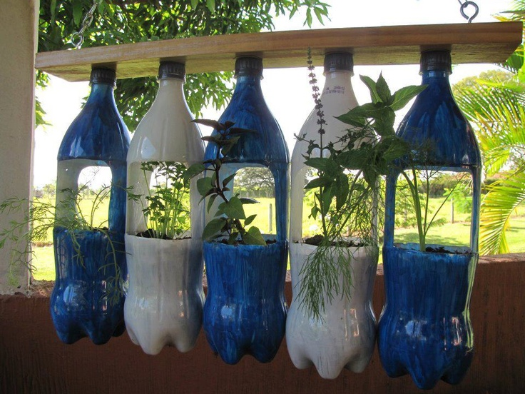 Hanging Recycled Soda Bottle Planter. If anyone has the actual instructions for this, that would be great. If you've made one, let me know!