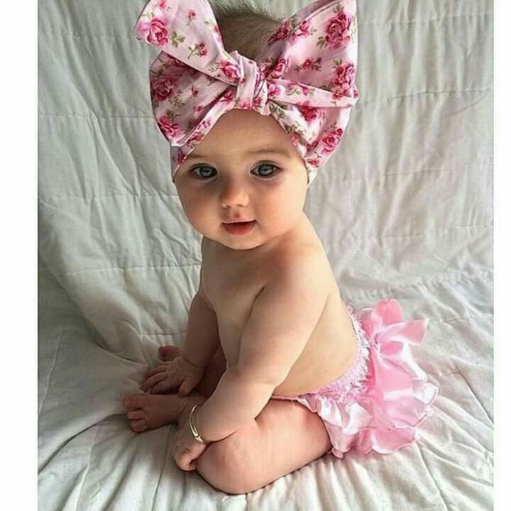 baby girl with big bow and a tutu