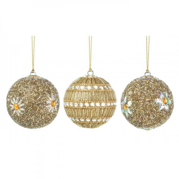 A touch of glamour is just what your tree needs to make your holiday truly shine. These classic ball ornaments are covered in sparkling golden and white faceted beads, and two of the ornaments feature
