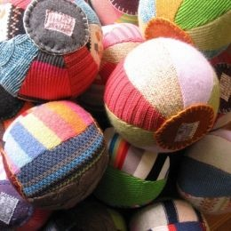 Handmade Pretties Soft Sweater Ball These cuddly balls are handcrafted from upcycled sweaters and are soft for baby to toss. They measure 12 inches in diameter and are multicolored. They are great gifts for all ages and cost $20.00