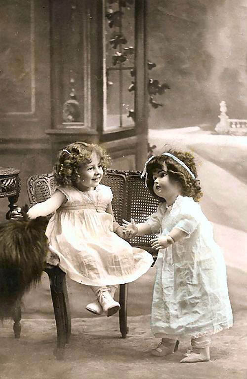 vintage photo little girl with doll