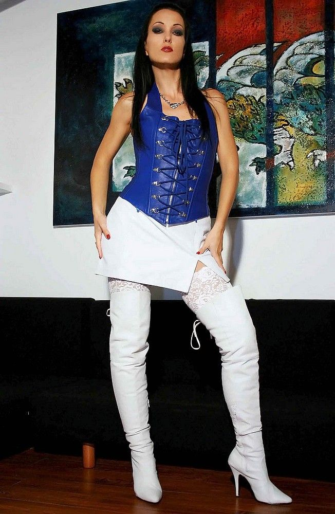 6b00dbb9b18 girl wearing white thigh high boots on white stockings with a short white  leather skirt