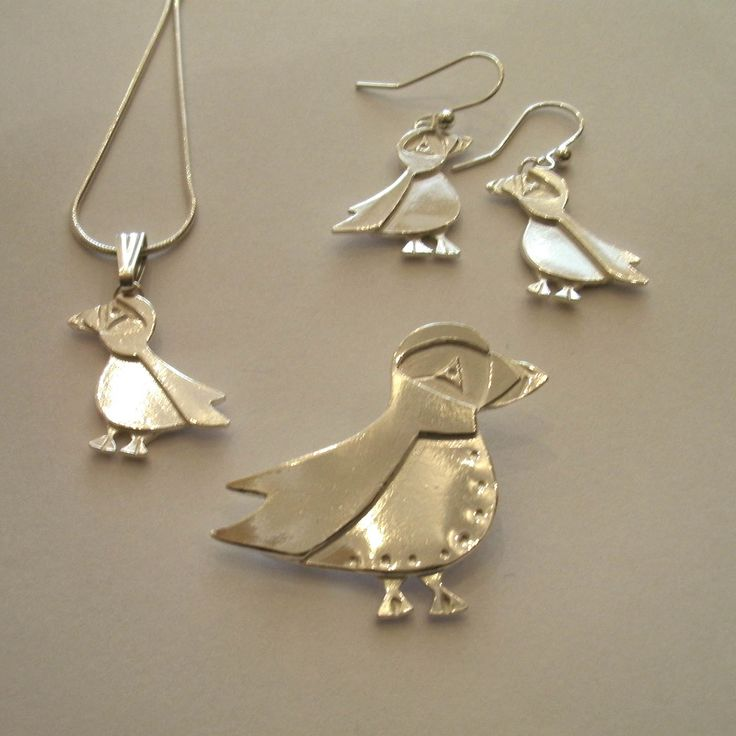 I suppose this is a flock of #silver #puffin jewellery. Sharon makes these for WOW! and we love them! We love them more in copper as they sell faster. The whole colony is found at www.thewowgallery.co.uk!