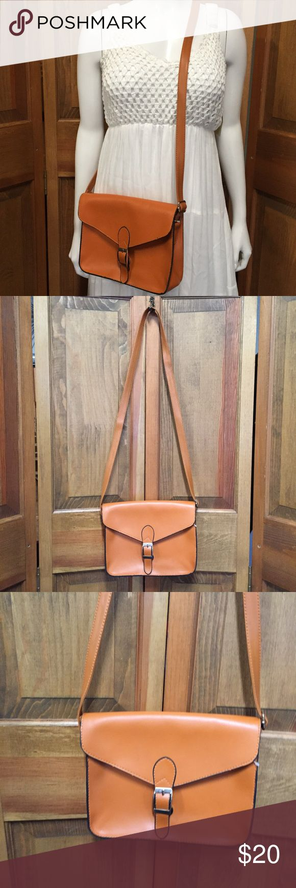 """Faux Leather Crossbody Purse Brown / Rust Shows normal wear with no damage and adjustable strap - 22.5"""" X 9.5"""" X 8.35"""" with a 20.75"""" strap drop  This item was listed on: 8/10/17  💛Like this item for pricing updates    💛Items ship out ASAP (usually 1 business day)   💛Questions / Measurements asked after 6pm Or on Sunday will be delayed but feel free to ask!   💛Save 15% by purchasing more than one item! Bags Crossbody Bags"""