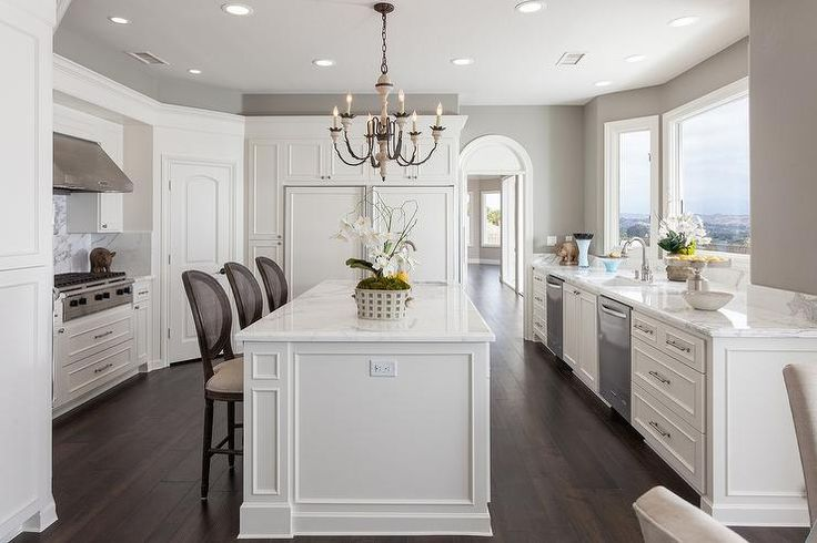 Stunning Laguna Niguel kitchen features pure white cabinets paired with statuary marble countertops and backsplash.