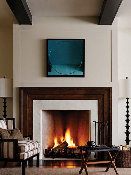 BARBARA BARRY Contemporary Fireplace Classic mouldings and symmetrical ceiling beams keep this look simple, letting furnishings and art take centre stage.