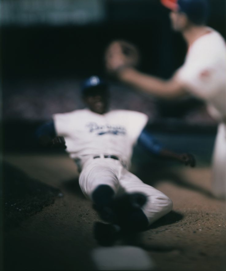 This image is another of Levinthal's that touches on a popular aspect of American culture, Baseball. The shallow DOF used to create movement is very powerful but, like in some of his other images, also leaves it open to the viewers imagination whether it's real or not.