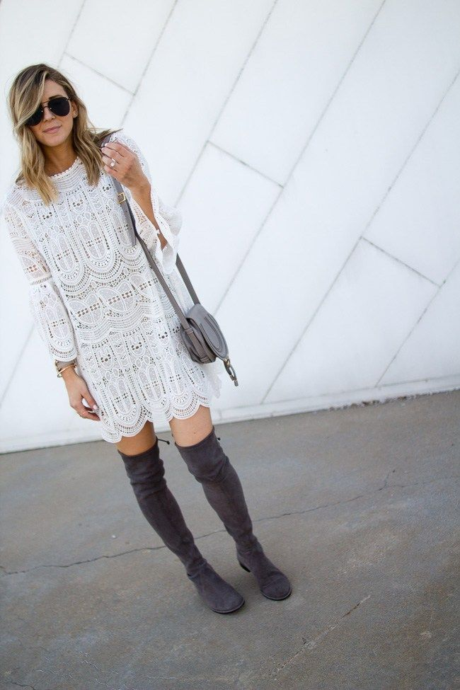 Grey Stuart Weitzman Over The Knee Boots And a White Lace Dress