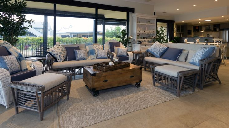 Relaxed living area with plantation cane furniture.
