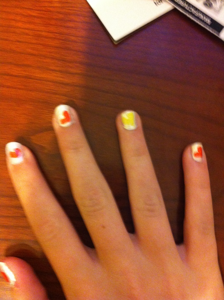 Halloween hearts. Paint orange and yellow hearts on a ...