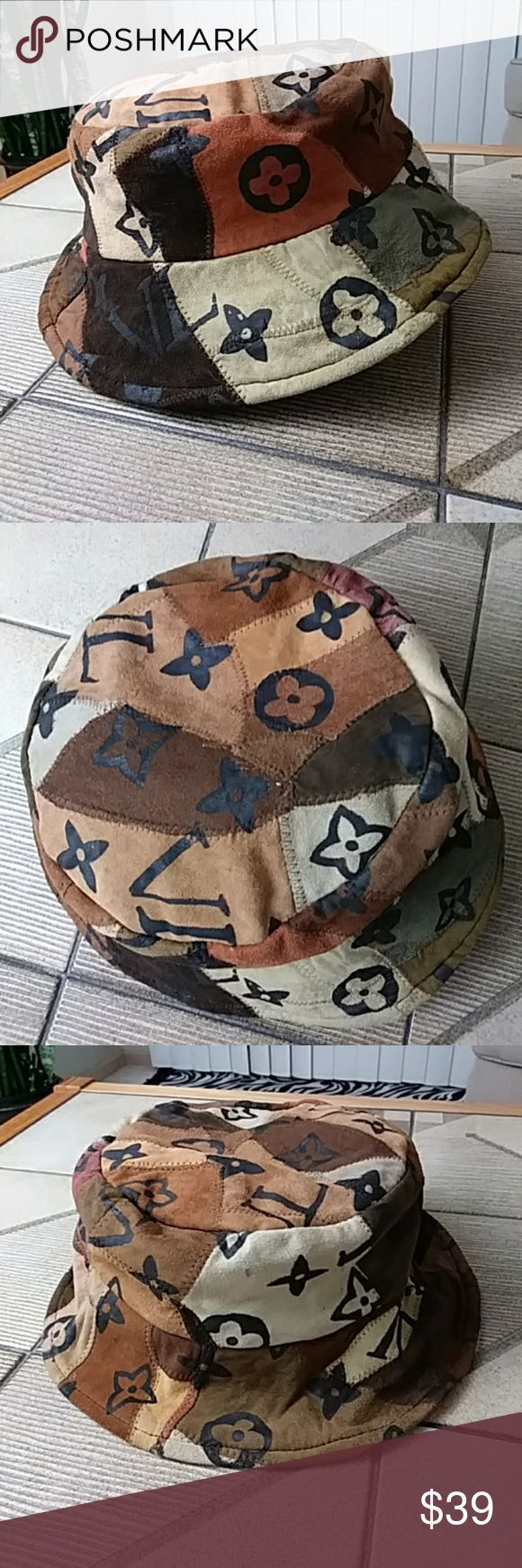 "Just in! Suede Patchwork Bucket Hat Unisex Patchwork Suede Bucket Hat. This one has character! Perfect for fall wear. Fully lined, 2.75"" brim. Preloved; a few spots or marks (please see photos), yet overall in excellent preowned condition. No rips, holes or tears. Brown, tan, camel, avocado and army green, cream, burnt orange, port wine, black. One size.  Approx 23.75"" circumference     Search Enhance: Bohemian, Boho, Retro, Louis Vuitton, Vintage, Cap, Accessories. Accessories Hats"