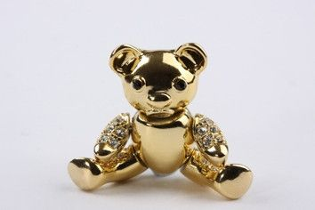 Teddy Bear Brooch Gold: Fun yet polished, this lovely design adds a playful aspect to a look. Swarovski crystals encrusted teddy bear brooch, with moveable limbs. 18 carat gold electroplated over brass.  $59.90
