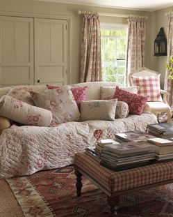 Pinner said; soft floral quilt used to cover up the couch...I think I could sink right into this spot on a rainy day!