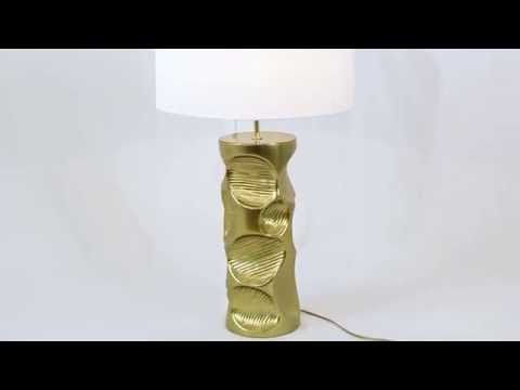 AMIK Modern Table Lamp reminds a lacquered piece of wood scooped by beaver teethes, that created a statement brass lighting piece | Discover more table lamps for bedroom ideas: http://masterbedroomideas.eu