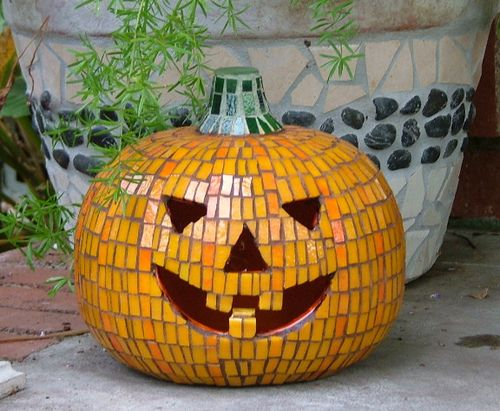 Glazed Mosaic Pumpkin~ idea: I made something like this once but it was a flat pumpkin and I made it with pieces of orange plates and it turned out really cool.