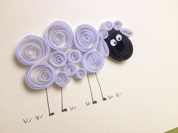 A quilled white fluffy sheep on beige card. These black faced sheep are all around the fields where I live in the west of Ireland. It makes a nice card for any occasion. It can be framed and decorate a nice nursery room. Quilling is a technique of rolling up thin strips of paper to