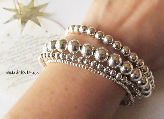 This set features 4 iconic and timeless sterling silver bead bracelets. One of each of the following sizes - 2mm, 4mm, 6mm and 8mm silver beads in the bracelet length of your choice.   A joyful addition to any woman's jewelry collection. A great and easy way to get that contemporary layered look. Sterling Silver Bead Bracelet Set of 4 by NikkiHillsDesign on Etsy