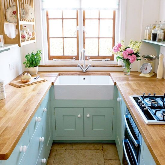 a sweet turquoise + natural wood kitchen
