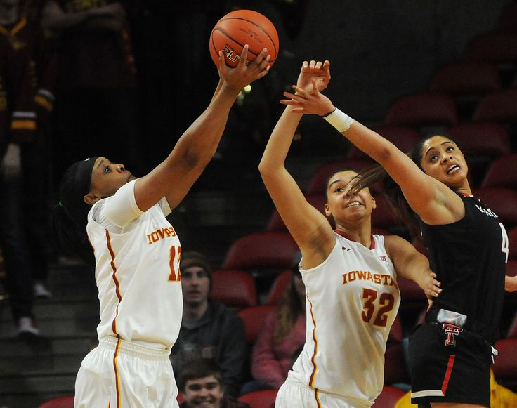 Iowa State's Seanna Johnson rebounds the ball as Meredith Burkhall  blocks Texas Tech's Recee Caldwell during the fourth quarter at Hilton Coliseum Wednesday, Feb. 15, 2017, in Ames, Iowa. Photo by Nirmalendu Majumdar/Ames Tribune http://www.amestrib.com/sports/20170215/women8217s-basketball-cyclones-down-lady-raiders-as-johnson-joins-rare-company