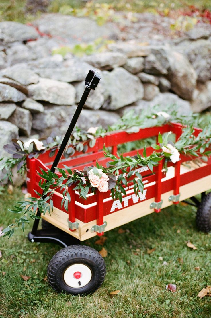 You could pull a tiny flower girl down the aisle in this decorated wagon. Photo by Ruth Eileen via Style Me Pretty