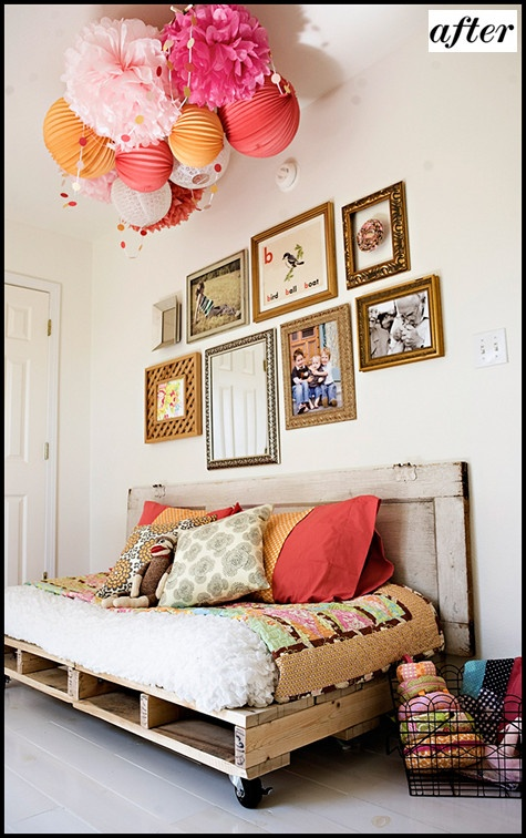 pallet couch Love the permanent lantern, tissue Pom display above and the unconventional arrangement of wall frames.