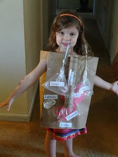 Then we made a wearable human body out of brown paper grocery bags, pasta, plastic bags, yarn, straws, and other things!! Found this idea, once again, on Homeschool Share!