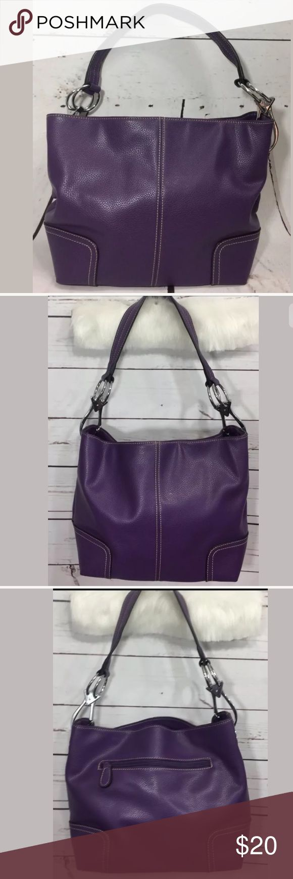 """Purple Purse hand bag shoulder bag Pretty purple hobo style purse. Only used a couple times. Adorable Polka Dot interior. Nice heavy duty hardware. I bought it in a little boutique in northern Michigan 🤗 14"""" wide 9"""" tall nice wide strap Bags Shoulder Bags"""