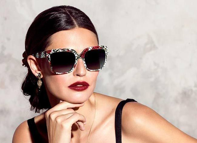 Bianca Balti for Dolce & Gabbana's SS 2015 eyewear campaign: a Spanish-Sicilian theme with carnations, fans, lace and standout eyewear styles.