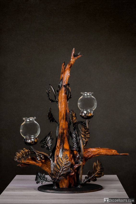 The Candlestick made from root with steel and glass in an innovative and artistic way made by http://decorroots.com