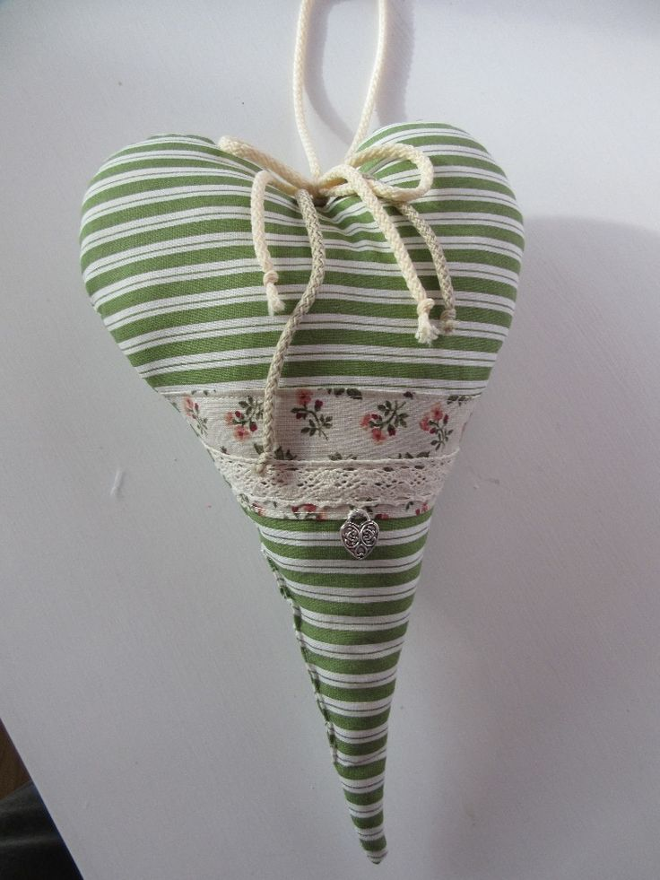 The hearts are padded for a soft touch to hold its shape. With decorative loop to be hang any place.
