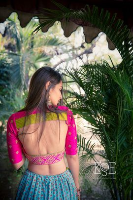 Indian Wedding Blouses - Manav & Parina | WedMeGood | Pink Backless Blouse with Green Detailing and Blue Lehenga #wedmegood #indianbride #indianwedding #backlesscholi #choli #blouse #lehenga #pink