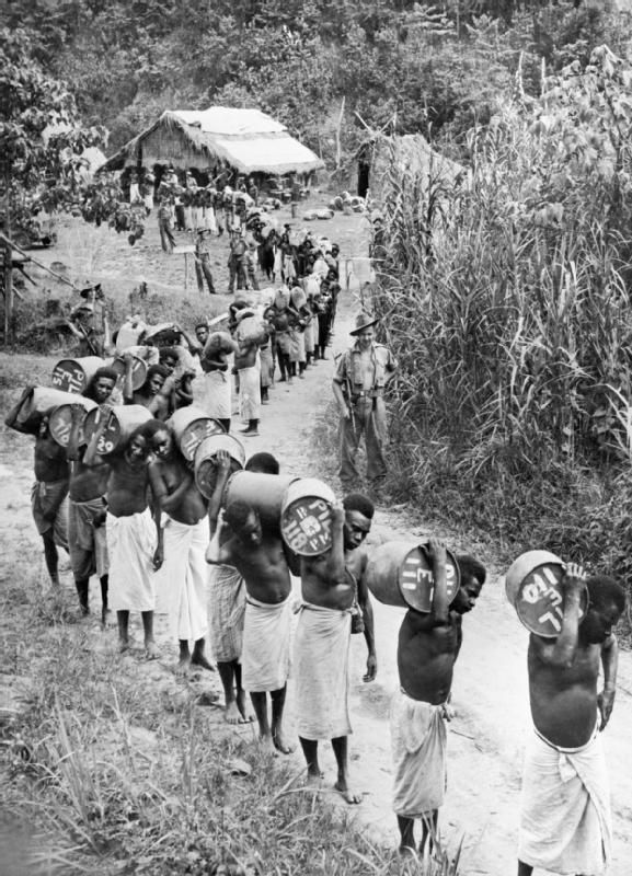 AUG 24 1943 Facing a Japanese night attack on New Guinea Papuan natives, known affectionately to the Australians as 'Fuzzy-Wuzzy angels', carry supplies during the fighting near Wau in New Guinea. The Australian forces owed much to native carriers who kept the forward troops supplied and helped to evacuate the wounded.