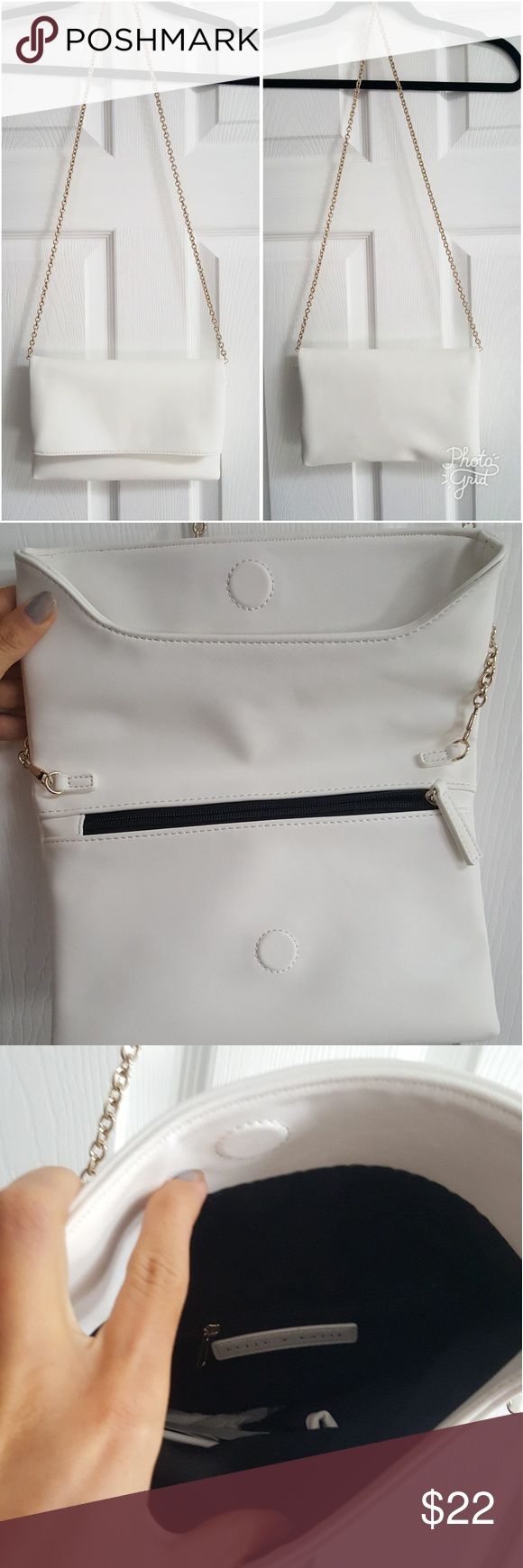 Kelly and Katie White and Gold Shoulder  Bag This bag is white with a gold removable chain allowing it to convert in to a clutch. The main compartment of the bag folds and shuts with a magnet. There are also a few zipper compartments, one of which is shown when you lift the bag to open it. Only used once, perfect condition. Kelly & Katie Bags Shoulder Bags