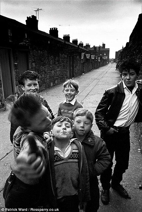 Boys playing in the back streets of Workington pose for a picture