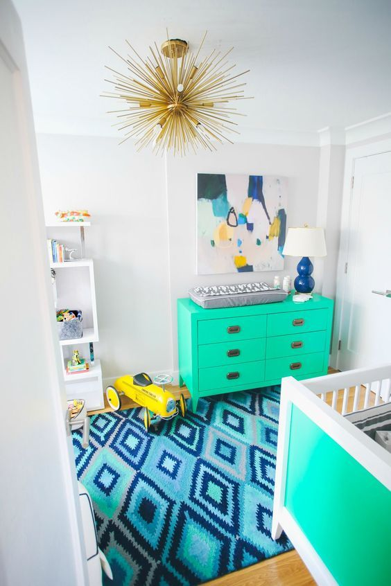Vivid shades of teal on the dresser and crib made a fantastic combination for this little boy's nursery! | Bright Blue and Teal Boy's Nursery | Barefoot Blonde