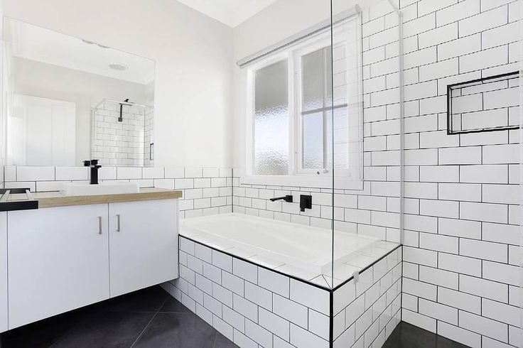 Who loves these Subway tiles? 😍 The black trim around the bathtub and shower niche compliment our basin mixer, spout, shower and towel rail perfectly in this stylish bathroom design by @novarahomes! meiraustralia#Meir #Meirblack #Meiraustralia #Blacktapware #Matteblacktapware #interiorlovers #bathroomdesign #bathroominspo #bathroomdecor #interiorstyle #interiorinspo #interiorandhome #renovationideas #interiordecorating