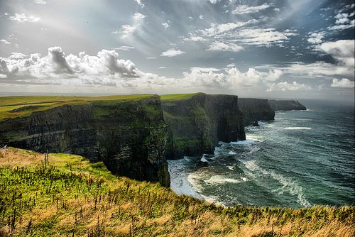 Cliffs of Moher, County Clare, Ireland. These massive cliffs are breathtaking in person - you really can't tell how enormous they truly are from photos