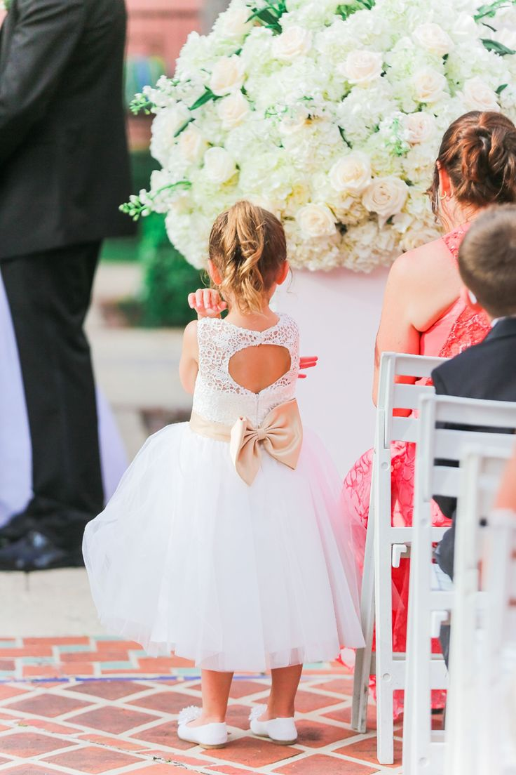 Perfectly adorable flower girl dress with a bow. We're in love! (Scribbled Moments Photography)