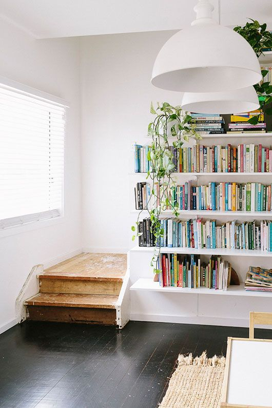 turn a stairwell wall into a bookshelf