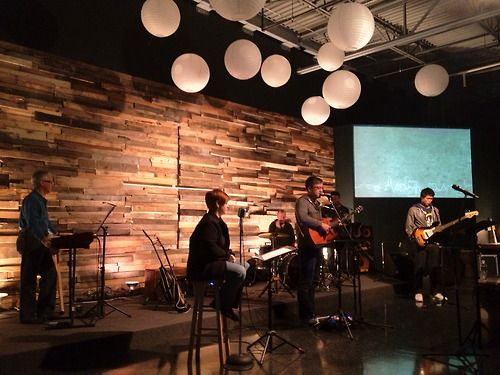 This non-traditional church transformed a former video store into a clean, modern worship space. A series of creative reredos (adornment behind the stage) has evolved with the life of the church.