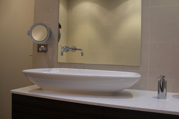 LAUFEN Bathrooms Palomba Bench Mounted Basin shown with the Windish Wall mounted mirror and Soap Dispenser    Products List:  Vola Wall Mixer and Spout  http://www.sydneybathroomware.com.au/Products/Vola-Wall-Mounted-Bath-Spout.aspx    Palomba Bench Basin  http://www.sydneybathroomware.com.au/Products/Laufen-Palomba-Bench-Basin.aspx    Windisch Wall Mounted Mirror  http://www.sydneybathroomware.com.au/Products/Windisch-Wall-Mounted-Mirror-99650-2.aspx