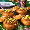 Mini bread bowls filled with chili...or clam chowder once the Patriots make it to the Super Bowl!